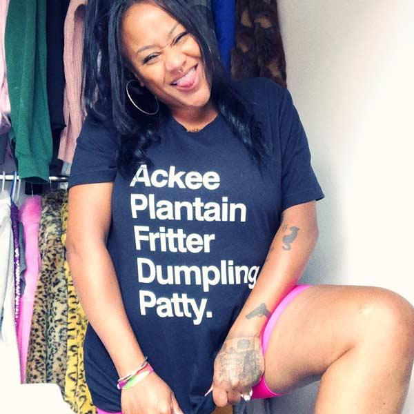 Sareta  wearing a slogan T -  Ackee Plantain Fritter Dumpling Patty T-shirt